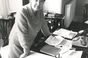 Beryl Paston Brown at her desk