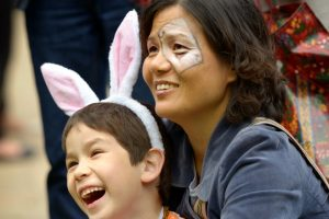 Two attendees with White Rabbit ears, and face paint