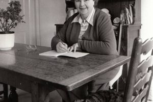 Dora Saint at her desk