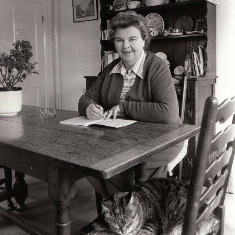 Dora Saint at her desk
